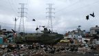 A Brazilian Navy armoured vehicle patrols the Manguinhos slum during a peacekeeping operation in Rio de Janeiro October 14, 2012