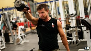 In this image obtained from www.redbullcontentpool.com, pilot Felix Baumgartner works out in a gym on October 7, 2012