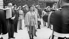 King of Cambodia Norodom Sihanouk, 23, reviews troops in June 1946 in Paris