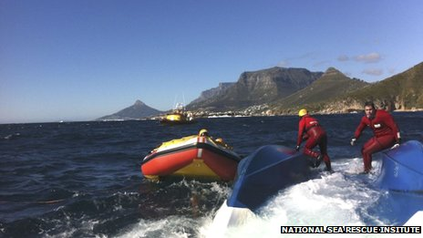 NSRI volunteers on the capsized hull of the charter boat off Cape Town