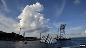 The Costa Concordia cruise ship lies near the harbour of Giglio on 14 October 2012