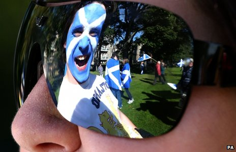 Scottish flag painted on a man's face