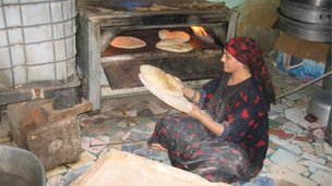 Woman baking in Egypt, file pic from 2012