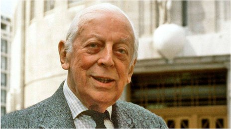 Alistair Cooke in front of Broadcasting House