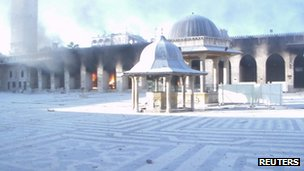 Fires burn at the Umayyad mosque in Aleppo, 13 October 2012