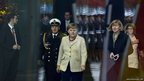German Chancellor Angela Merkel prepares to greet Panama's President at the chancellery
