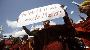 A Buddhist monk holds a sign as he takes part in a demonstration against the Organisation of the Islamic Conference - October 15, 2012.
