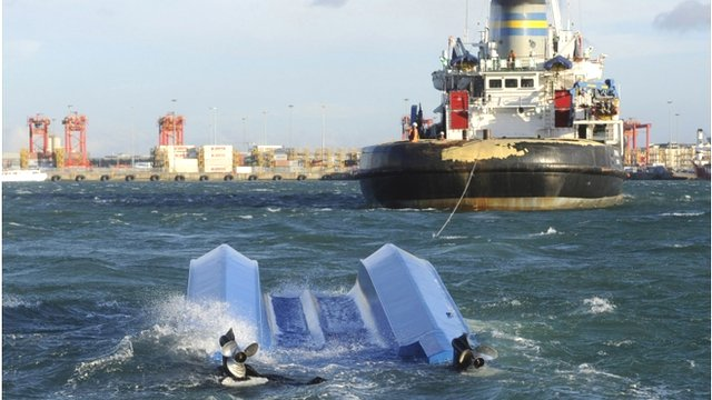 Rescuers tow a charter boat that capsized on a popular sight-seeing trip in Cape Town