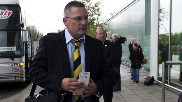 Craig Levein arrives at Bristol Airport as Scotland leave for Belgium