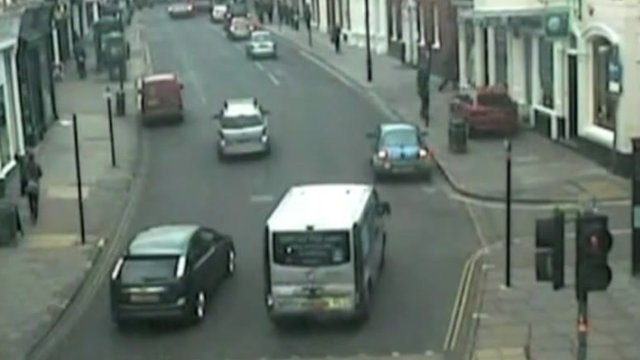 CCTV of the car mounting the pavement