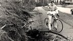 A cyclist views the huge hole left by an uprooted tree on Mote Road, Maidstone, Kent.