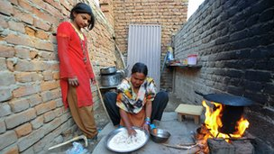 A woman cooking food in Pakistan