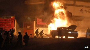 Police put out a fire after a clash with students involved in campus takeovers in Tiripetío, Michoacan state, Mexico.