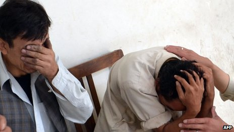 Shias mourn the killing of their relatives at a hospital following the  attack by gunmen in Quetta
