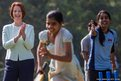 Australian Prime Minister Julia Gillard watches as children play cricket at a cricket clinic hosted by NGO Magic Bus which helps underprivileged children in New Delhi, India