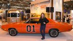 Actress Catherine Bach, the original Daisy Duke from the television series The Dukes of Hazzard with the General Lee car