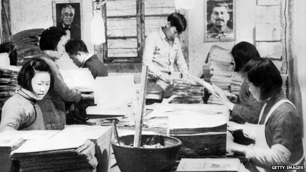 A section of the printing plant run by the communists in Northern China. Photographs of Stalin and President Franklin Delano Roosevelt are seen on the walls. Mao Tse Tung rules the area with an iron fist and as a consequence the area is in fact a state within a state.