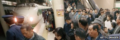 Crowds await a bullet train at Ueno station in Tokyo in 1988