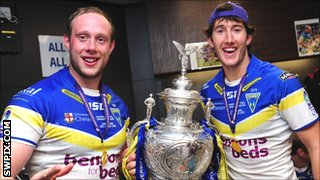 Warrington's Chris Hill (l) and Stefan Ratchford with the Challenge Cup trophy
