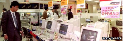 Japanese man browses computers for sale in a Tokyo department store in 1992