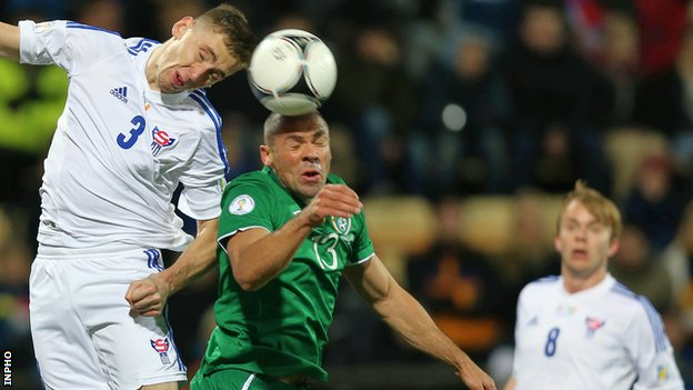 Pól Jóhannus Justinussen of the Faroe Islands in action against the Republic of Ireland's Jon Walters