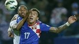 Wales' Ashley Williams challenges Croatia goal-scorer Mario Mandzukic