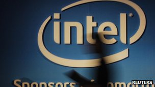 Woman's shadow on Intel sign