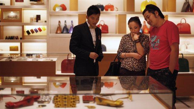 A couple shopping at a Louis Vuitton store in Shanghai