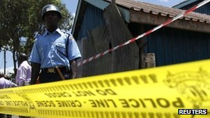 Policemen secure the scene of an explosion at the Anglican Church of Kenya Sunday school in the Kenyan capital Nairobi, September 30, 2012.