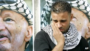 A Palestinian man weeps outside Yasser Arafat's compound in the West Bank city of Ramallah Nov. 11, 2004, after Arafat's death was announced 