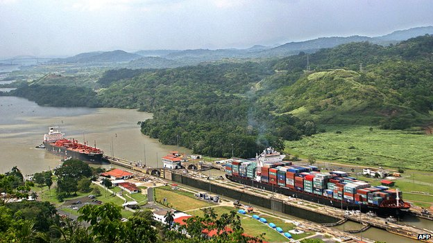 Ships pass through the Panama Canal's Pedro Miguel locks