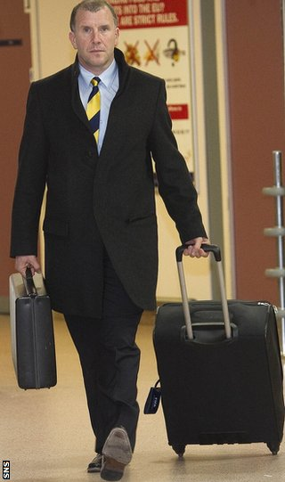 Regan arrives back at Glasgow Airport after the defeat in Brussels