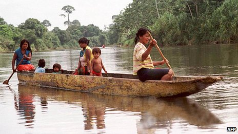 Residents of the Panamanian town of Vista Alegre travel in a canoe through the jungles near the Colombian border