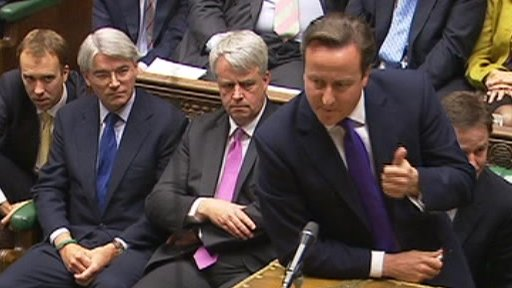 David Cameron, with Andrew Mitchell watching on