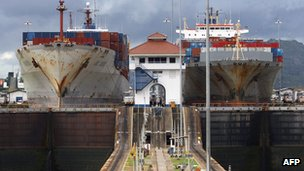 Ships passing through the Panama Canal's Miraflores locks