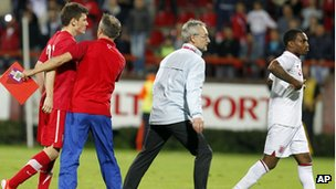 Serbian player Milos Ninkovic, left, and England player Danny Rose, right, react during their 2013 UEFA European Under-21 Championship play-off
