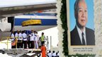 Cambodian honour guards lifting former King Norodom Sihanouk's body from a plane at the Phnom Penh International Airport, 17 October 2012