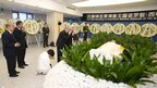 Cambodian Queen Norodom Monineath Sihanouk (left, 5th), King Norodom Sihamoni (left, 4th) and Prime Minister Hun Sen (left, 2nd), praying in front of the body of former King Norodom Sihanouk at China's Beijing Hospital, 17 Oct 2012