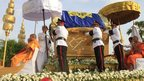 The casket containing the body of Cambodia's former king, Norodom Sihanouk, is carried by a flotilla of phoenix in Cambodia, 17 October 2012