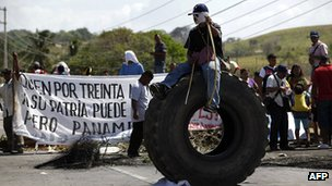 Indigenous Panamanians block the pan-American Highway in protest against planned changes to the mining laws