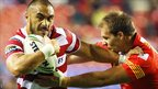 Tommy Leuluai shrugs off Gregory Mounis