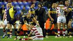 Carl Ablett consoles Harrison Hansen after Leeds beat Wigan