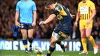 Kevin Sinfield kicks for goal