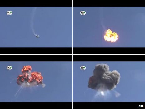 Grabs from a video posted in YouTube showing a helicopter exploding