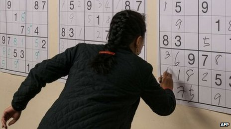 Woman doing sudoku 