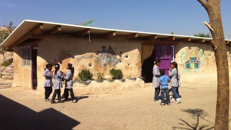 Bedouin children are taught at Khan al-Ahmar school