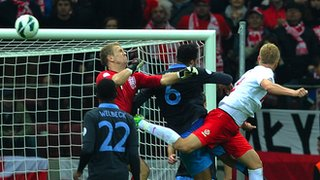 Kamil Glik (right) heads in Poland&#039;s equaliser against England