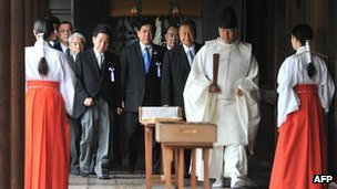 A Shinto priest leads a group of Japanese lawmakers during a visit to the controversial Yasukuni Shrine in Tokyo on 18 October 2012