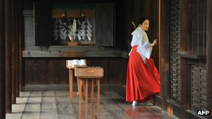 A maiden setting up a reception for visiting Japanese officials at the controversial Yasukuni Shrine in Tokyo, 18 October 2012