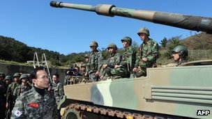 South Korean President Lee Myung-Bak (L) talking with marines at Yeonpyeong Island, 18 October 2012